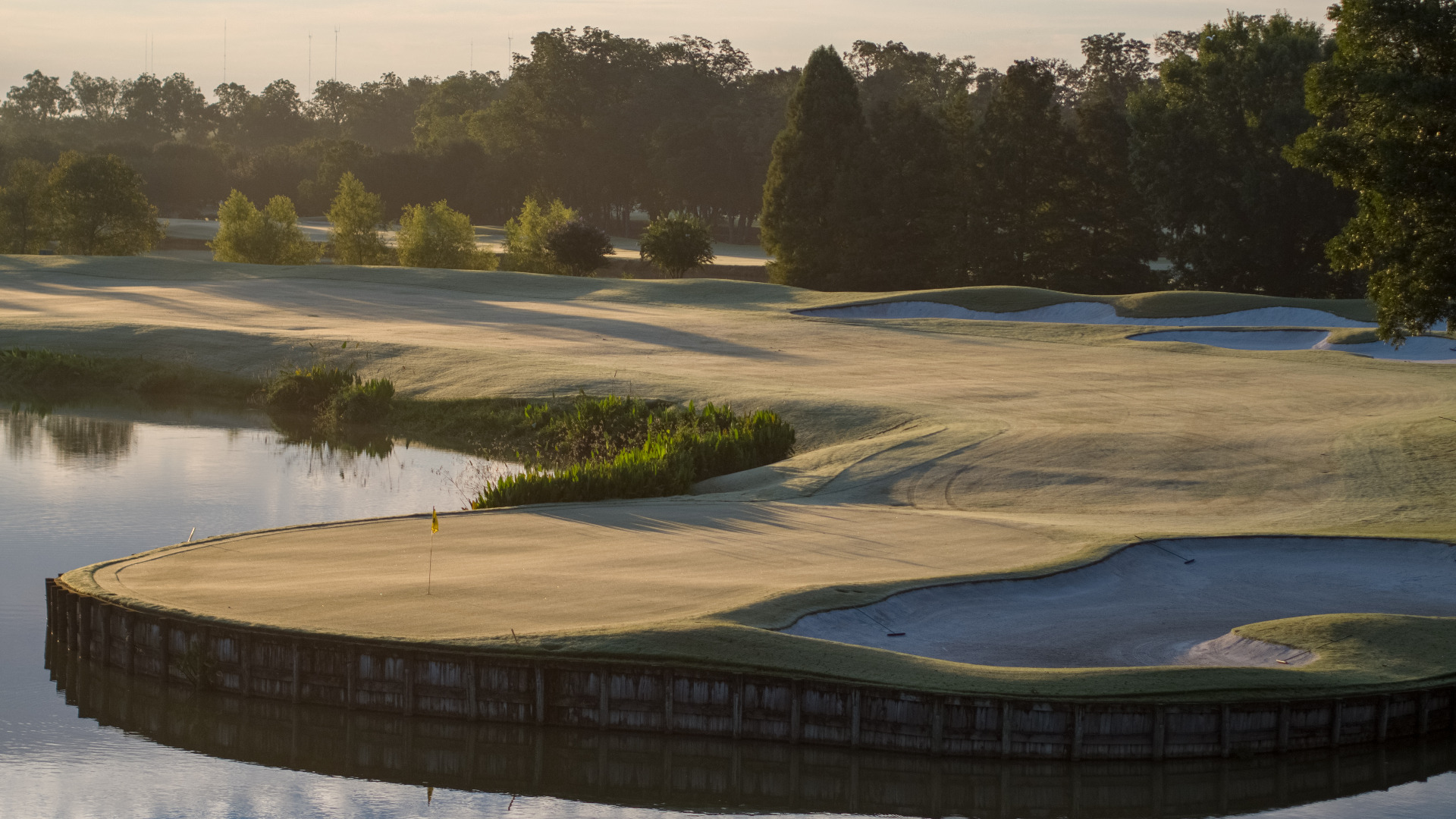 Sand dunes touch the water's edge at Shadow Hawk Golf Club
